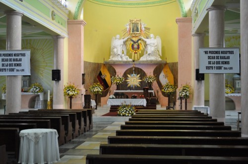 "Interior of the church above in Cotacachi.  The posters have a verse from Acts, chapter 4, in which the apostles Peter and John are warned by the religious authorities not to speak about the risen Jesus.  They replied,  ""Whether it is right in the sight of God to listen to you rather than to God, you must judge, for we cannot but speak of what we have seen and heard."""